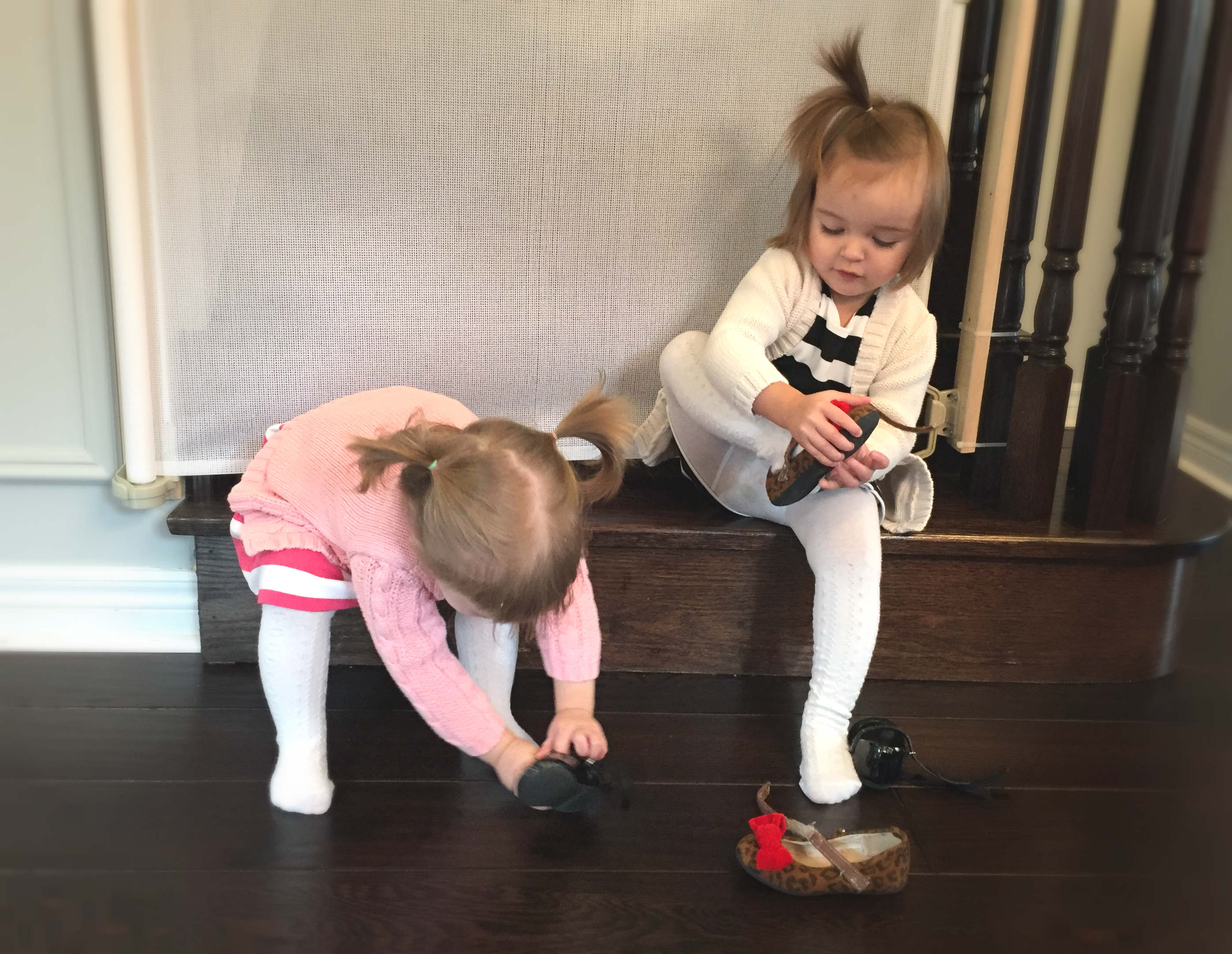 Twins putting shoes on