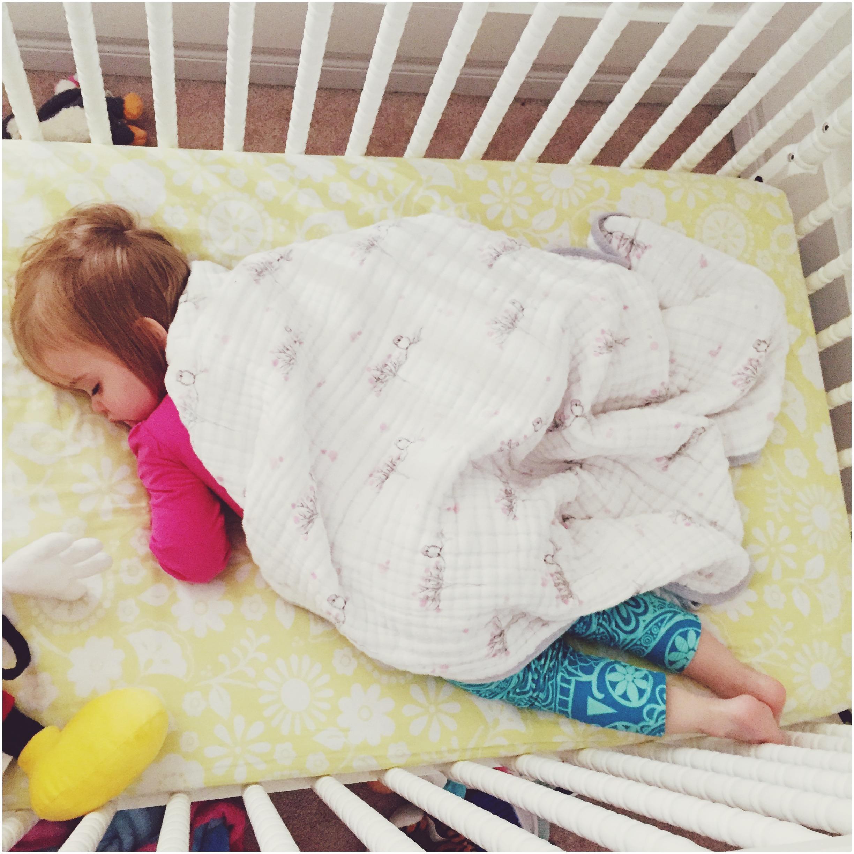 Mia sleeping in crib
