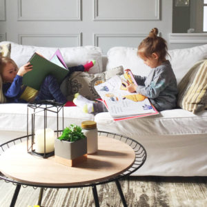 Kids reading on a couch