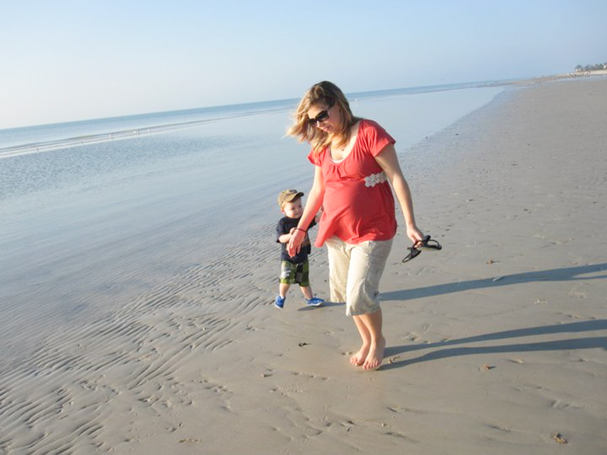mother and son walking on beach