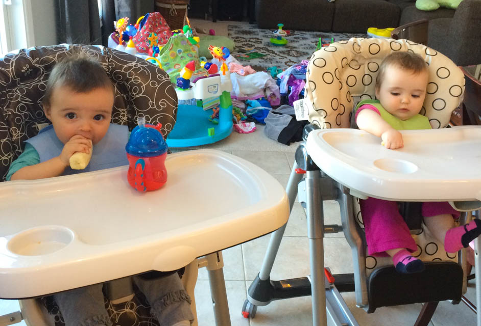 Twins in highchairs