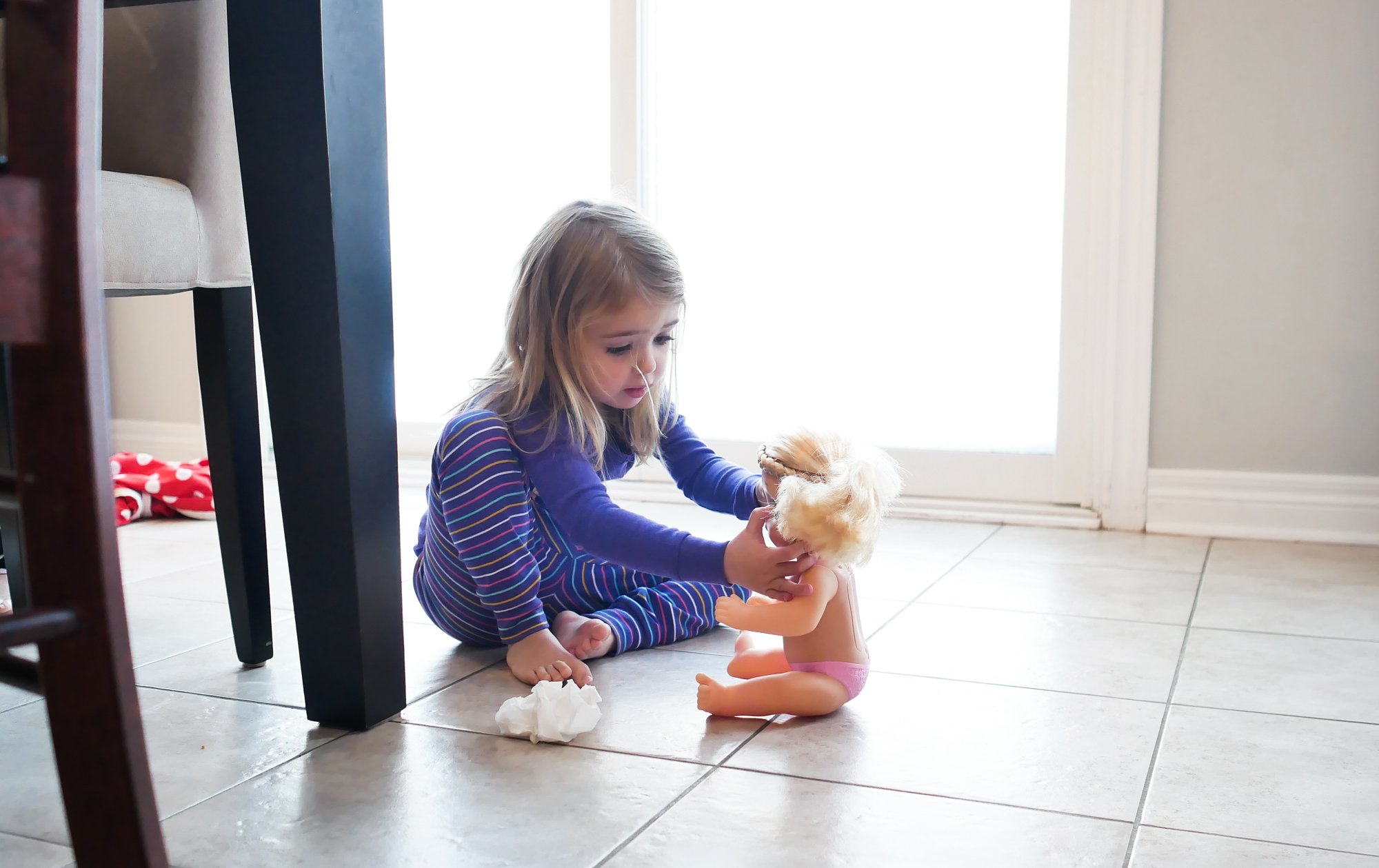 toddler playing with doll