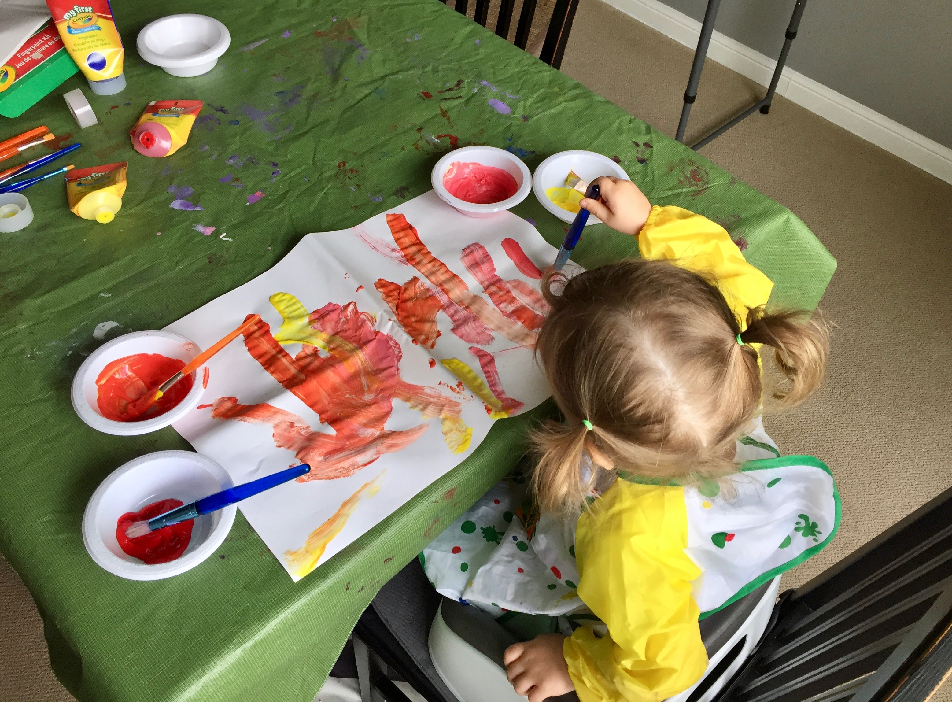 Painting is a great way to entertain a toddler