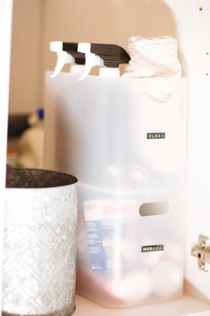 put all like things together under your bathroom sink by Nesting Story